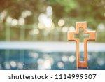 wooden christian cross with...   Shutterstock . vector #1114999307