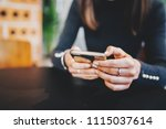 closeup of female hands using... | Shutterstock . vector #1115037614