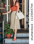 partial view of stylish woman... | Shutterstock . vector #1115045744