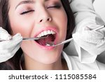 dentist examines the teeth of... | Shutterstock . vector #1115085584