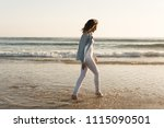 beautiful woman enjoying sunset ... | Shutterstock . vector #1115090501