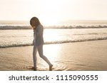 beautiful woman enjoying sunset ... | Shutterstock . vector #1115090555