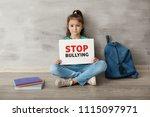 little girl sitting on floor... | Shutterstock . vector #1115097971