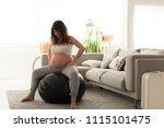 pregnant woman doing relax... | Shutterstock . vector #1115101475
