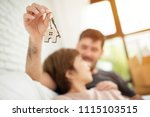 young man surprising woman with ... | Shutterstock . vector #1115103515