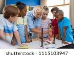 teacher teaching children math... | Shutterstock . vector #1115103947