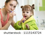 happy mother and child daughter ... | Shutterstock . vector #1115143724
