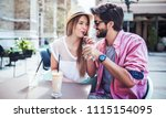 flirting in a cafe. beautiful... | Shutterstock . vector #1115154095