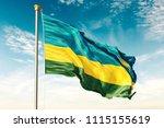 rwanda flag on the blue sky... | Shutterstock . vector #1115155619