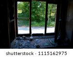 the broken window of destroyed... | Shutterstock . vector #1115162975