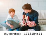 father playing guitar to his... | Shutterstock . vector #1115184611