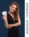 beautiful brunette holding two... | Shutterstock . vector #1115190164