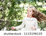 child dance to music in summer... | Shutterstock . vector #1115198135