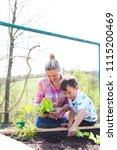 beautiful mother and her blond... | Shutterstock . vector #1115200469