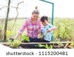 beautiful mother and her blond... | Shutterstock . vector #1115200481
