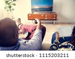 couple watching tv at home... | Shutterstock . vector #1115203211