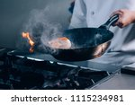 shrimp flambe on fire | Shutterstock . vector #1115234981