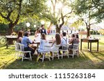 bride and groom with guests at...   Shutterstock . vector #1115263184