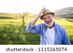 portrait of a senior man in... | Shutterstock . vector #1115265074