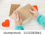 hand of girl writing love... | Shutterstock . vector #1115282861