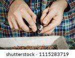 sharpening a pencil with a... | Shutterstock . vector #1115283719
