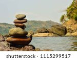 stacked rocks by the beach | Shutterstock . vector #1115299517