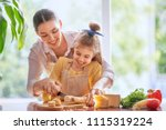 family breakfast. mother and... | Shutterstock . vector #1115319224
