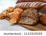 assortment of baked french bread | Shutterstock . vector #1115319335