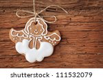 Gingerbread Angel Hanging Over...