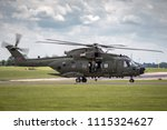 Small photo of RAF Waddington, Lincolnshire, UK - July 5, 2014: Royal Air Force (RAF) AgustaWestland Merlin HC3 (EH-101) ZK001 medium lift utility helicopter.