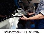 car mechanic repairing broken... | Shutterstock . vector #111533987