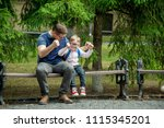 father and son playing  ... | Shutterstock . vector #1115345201