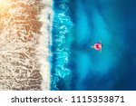 aerial view of woman swimming... | Shutterstock . vector #1115353871