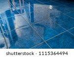shiny blue tiled bathroom floor ...   Shutterstock . vector #1115364494
