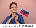 woman holding flag of... | Shutterstock . vector #1115373401