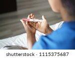 black woman holding positive... | Shutterstock . vector #1115375687