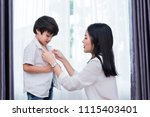 young asian mom dressed up son... | Shutterstock . vector #1115403401