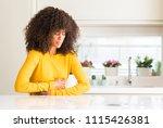 african american woman wearing... | Shutterstock . vector #1115426381