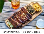 st louis style bbq ribs with... | Shutterstock . vector #1115431811