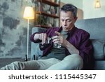 man in despair. grey haired no... | Shutterstock . vector #1115445347