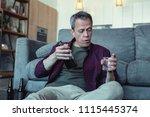 glass of vodka. mature badly... | Shutterstock . vector #1115445374