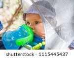 a man with his baby boy are... | Shutterstock . vector #1115445437