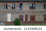 Small photo of abandoned wooden barracks