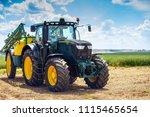 tractor with sprayer trailer... | Shutterstock . vector #1115465654