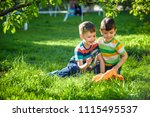 two adorable kid boy making... | Shutterstock . vector #1115495537