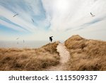 barefoot in the dunes on the... | Shutterstock . vector #1115509337