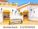 typical white architecture with ... | Shutterstock . vector #1115533424