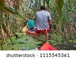 canoeing in a wild overgrown...   Shutterstock . vector #1115545361