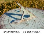 A Vintage Sundial With Green...