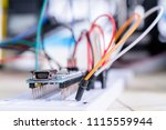 breadboard connected to arduino.... | Shutterstock . vector #1115559944